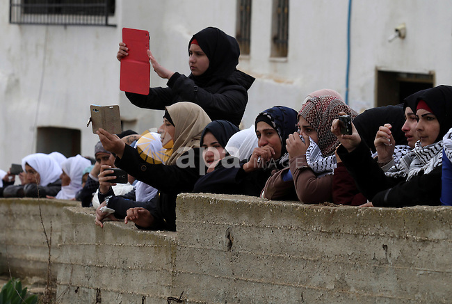 Relatives of Palestinian Samah Abd al-Mumen mourn during her funeral in the West Bank city of Nablus, on December 17, 2015. Samah died on Wednesday at Benlson Hospital from wounds she had sustained nearly two months previously, when she was caught in Israeli crossfire during a stabbing incident at Huwarra Checkpoint. Photo by Nedal Eshtayah