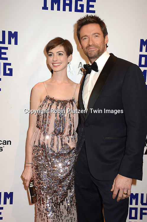 Anne Hathaway in Nina Ricci beige and silver dress and Hugh Jackman attend the Museum of the Moving Image Salute to Hugh Jackman on December 11,2 012 at Cipriani Wall Street in New York City.