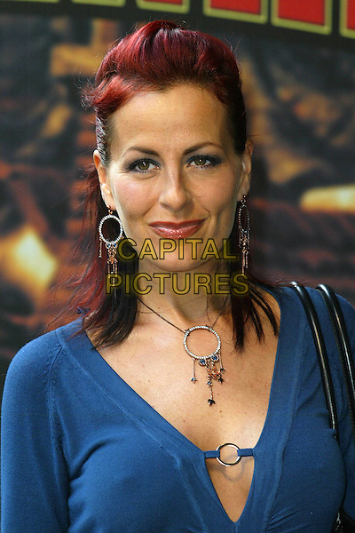 "CARRIE GRANT.At the UK Film Premiere of ""Hoodwinked"",.Vue West End Cinema, London,.England, September 24th 2006..portrait headshot blue top necklace earrings jewellery.Ref: DAR.www.capitalpictures.com.sales@capitalpictures.com.©Darwin/Capital Pictures"