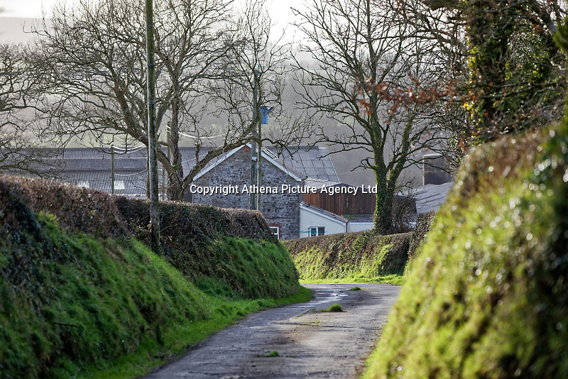 """Pictured: The entrance to the diary farm owned by David Aeron Owens in St Clears, Wales, UK. Wednesday 05 February 2020<br /> Re: Dyfed-Powys Police has become the first police force in the UK to use DNA evidence from a stolen cow in a criminal court case.<br /> The force used DNA from a £3,000 heifer, which had been retagged by a neighbouring farmer after escaping from a field, to prove it had been stolen.<br /> The blood samples were compared against cows on the victim's farm to prove a familial link and secure a conviction.<br /> David Aeron Owens, of Salem Road, St Clears, pleaded guilty to theft at Swansea Crown Court on Monday, February 3.<br /> PC Gareth Jones, officer in case, said: """"This has been a long and protracted enquiry, and it has taken a lot of work and patience to get to this point.<br /> """"Without the use of the heifer's DNA we would not have been able to prove that it had been stolen by Mr Owens, and that he had tried to alter identification tags to evade prosecution.<br /> """"We are proud to be the first force in the UK to use a cow's DNA in a criminal case, and will continue to use innovative methods to get justice for victims.""""<br /> The investigation started in December 2017, when a farmer in St Clears reported the theft of one of his 300 cows which had escaped from his field four months earlier.<br /> Mr Owens had denied the missing animal was on his land, but the victim recognised it among the herd.<br /> PC Jones visited the farm and was handed a cow passport, listing ear tag numbers for the cow in question and the animal Mr Owens alleged was its mother.<br /> PC Jones applied for a warrant to seize the stolen cow, which was separated from the herd and had blood samples taken for DNA comparison."""