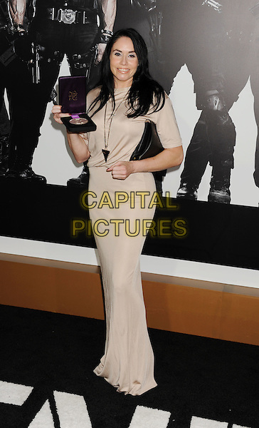 "Lindsey Berg.""The Expendables 2"" Los Angeles Premiere held at Grauman's Chinese Theatre, Los Angeles, California, USA..August 15th, 2012.full length cream beige dress black clutch bag medal winner .CAP/ROT/TM.©Tony Michaels/Roth Stock/Capital Pictures"