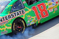 Sept. 21, 2008; Dover, DE, USA; Nascar Sprint Cup Series driver Kyle Busch has smoke from his car after engine problems during the Camping World RV 400 at Dover International Speedway. Mandatory Credit: Mark J. Rebilas-