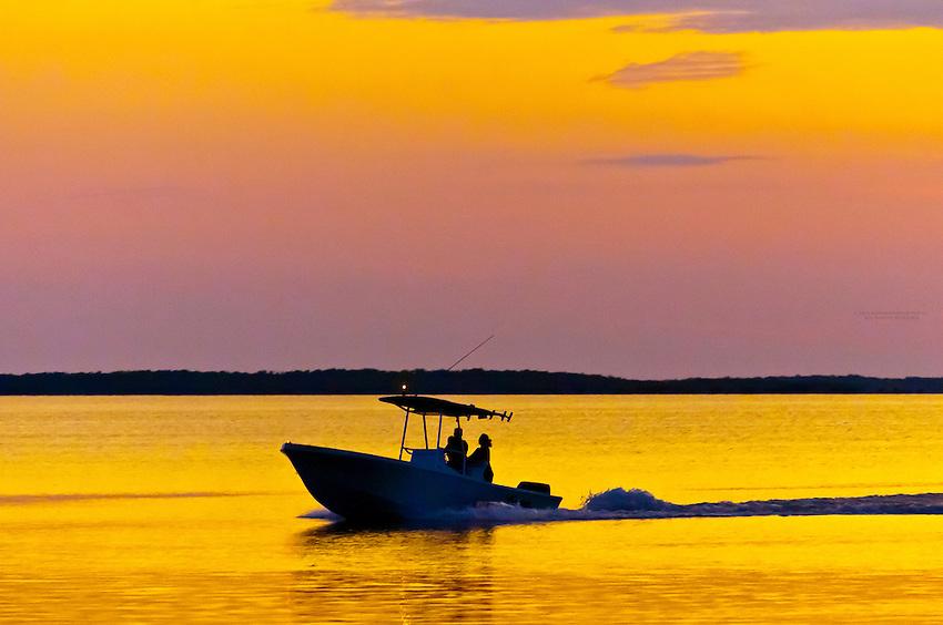 Boat  off of the Kona Kai resort at sunset, Key Largo, Florida Keys, Florida USA