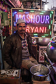 A shop vendor selling Biryani poses for a photo at his stall in Nizamuddin, New Delhi, India.