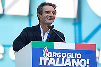 """Attilio Fontana (Member of Lega/League, President of Lombardia Region).<br /> <br /> Rome, 19/10/2019. Today, tens thousands of people (200,000 for the organisers, 50,000 for the police) gathered in Piazza San Giovanni to attend the national demonstration """"Orgoglio Italiano"""" (Italian Pride) of the far-right party Lega (League) of Matteo Salvini. The demonstration was supported by Silvio Berlusconi's party Forza Italia and Giorgia Meloni's party Fratelli d'Italia (Brothers of Italy, right-wing).  <br /> The aim of the rally was to protest against the Italian coalition Government (AKA Governo Conte II, Conte's Second Government, Governo Giallo-Rosso, 1.) lead by Professor Giuseppe Conte. The 66th Government of Italy is a coalition between Five Star Movement (M5S, 2.), Democratic Party (PD – Center Left, 3.), and Liberi e Uguali (LeU – Left, 4.), these last two parties replaced Lega / League as new members of a coalition based on Parliamentarian majority as stated in the Italian Constitution. The Governo Conte I (Conte's First Government, 5.) was 14-month-old when, between 8 and 9 of August 2019, collapsed after the Interior Minister Matteo Salvini withdrew his euroskeptic, anti-migrant, right-wing Lega / League (6.) from the populist coalition in a pindaric attempt (miserably failed) to trigger a snap election.<br /> <br /> Footnotes & Links:<br /> 1. http://bit.do/feK6N<br /> 2. http://bit.do/e7JLx<br /> 3. http://bit.do/e7JKy<br /> 4. http://bit.do/e7JMP<br /> 5. http://bit.do/e7JH7<br /> 6. http://bit.do/eE7Ey<br /> https://www.leganord.org<br /> http://bit.do/feK9X (Source, TheGuardian.com)<br /> Reportage: """"La Fabbrica Della Paura"""" (The Factory of Fear): http://bit.do/feLcy (Source Report, Rai.it - ITA)<br /> (Update) Reportage: """"La Fabbrica Social Della Paura"""" (The Social Network Factory of Fear): http://bit.do/fe8Pn (Source Report, Rai.it - ITA)"""