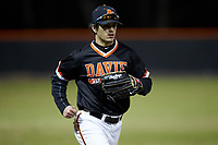 Davie War Eagles left fielder Hite Merrifield (21) jogs off the field between innings of the game against the Lake Norman Wildcats at Davie County High School on March 7, 2018 in Mocksville, North Carolina.  The Wildcats defeated the War Eagles 12-0.  (Brian Westerholt/Four Seam Images)