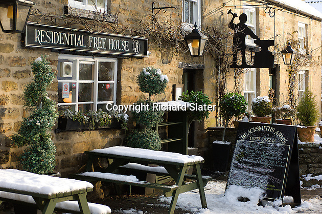 A heavy fall of snow adds to the charms of the Blacksmith's Arms in Lastingham, the North Yorkshire Moors, England.