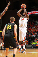 Dec. 17, 2010; Charlottesville, VA, USA; Virginia Cavaliers guard K.T. Harrell (24) shoots the ball over Oregon Ducks forward E.J. Singler (25) during the game at the John Paul Jones Arena. Virginia won 63-48. Mandatory Credit: Andrew Shurtleff-