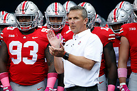 Ohio State Buckeyes head coach Urban Meyer stands with the team before the first half of their game at Ohio Stadium in Columbus, Ohio on October 7, 2017.   [Brooke LaValley / Dispatch]