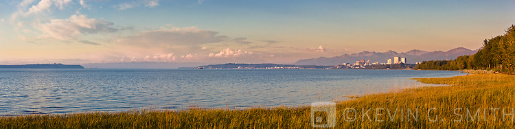 The Anchorage Skyline  just before sunset, taken from the Tony Knowles Coastal Trail, high tide, late summer, Anchorage, Southcentral Alaska, USA.