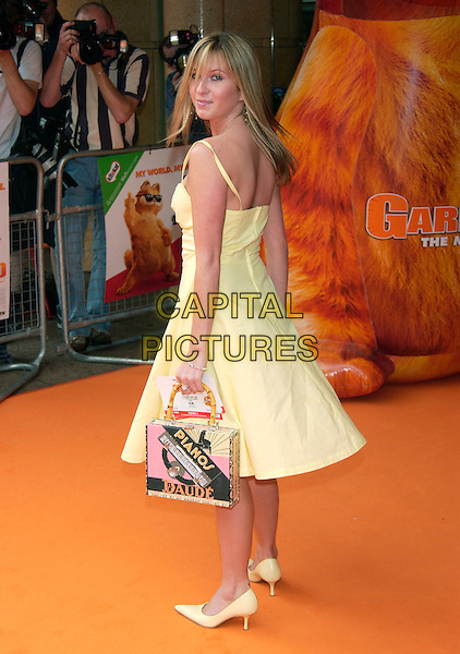 "BROOKE KINSELLA .""Garfield : The Movie"" UK charity premiere in aid of Great Ormond Street Children's Hospital,.Vue cinema, Leicester Square,.London, 25th July 2004..full length yellow baby doll slip dress stilettoes.Ref: PL.www.capitalpictures.com.sales@capitalpictures.com.©Capital Pictures"