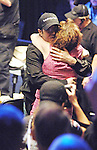 Gold hugs his mother