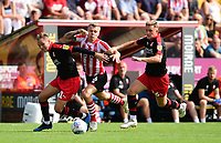 Lincoln City's Harry Anderson vies for possession with Swindon Town's Matthew Taylor, left, and Swindon Town's Martin Smith<br /> <br /> Photographer Chris Vaughan/CameraSport<br /> <br /> The EFL Sky Bet League Two - Lincoln City v Swindon Town - Saturday 11th August 2018 - Sincil Bank - Lincoln<br /> <br /> World Copyright &copy; 2018 CameraSport. All rights reserved. 43 Linden Ave. Countesthorpe. Leicester. England. LE8 5PG - Tel: +44 (0) 116 277 4147 - admin@camerasport.com - www.camerasport.com