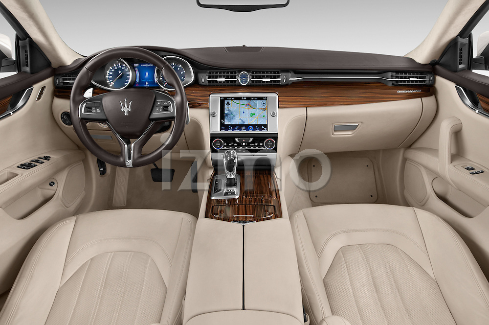 Stock photo of straight dashboard view of a 2014 Maserati Quattroporte SQ4 4 Door Sedan Dashboard