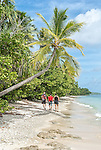 Travellers exploring the coastline on the northern point of Funafuti Atoll, Tuvalu