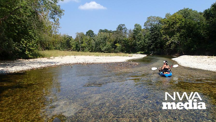 NWA Democrat-Gazette/FLIP PUTTHOFF<br />Nichols drifts Sept. 15 2017 down a stretch of Little Sugar Creek. Her kayak was ideal for the low water level.