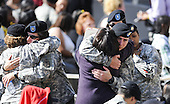 Fort Hood, TX - November 10, 2009 -- Soldiers embrace each other while waiting for the start of the memorial service for the 12 soldiers and one civilian killed at Fort Hood U.S Army Post near Killeen, Texas, USA 10 November 2009. Army Major Malik Nadal Hasan reportedly shot and killed 13 people, 12 soldiers and one civilian, and wounded 30 others in a rampage 05 November at the base's Soldier Readiness Center where deploying and returning soldiers undergo medical screenings. .Credit: Tannen Maury / Pool via CNP