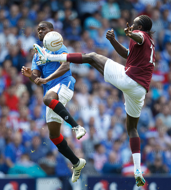 Maurice Edu gets a boot from David Obua
