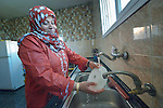 Nahla Abudagga washes dishes with water collected in a rainwater harvesting system at her home in Al Fukari, Gaza. The family had built a system before, but Israeli air strikes in 2014 destroyed that system and damaged the family's house. With help from Diakonie Katastrophenhilfe, a member of the ACT Alliance, they rebuilt the water system and have repaired some of the damage to their home. In the wake of the devastating 2014 war, ACT Alliance members are supporting health care, vocational training, rehabilitation of housing and water systems, psycho-social care, and other humanitarian actions throughout the besieged Palestinian territory.