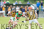 Abbeydorney full forward Brian O'Leary holds on to the charging Richard Nolan, Crotta when the sides met in Ballyduff GAA grounds last Saturday evening