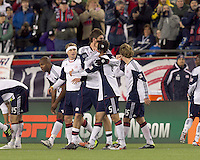 New England Revolution midfielder Stephen McCarthy (26) celebrates his goal with teammates. In a Major League Soccer (MLS) match, the New England Revolution tied the Portland Timbers, 1-1, at Gillette Stadium on April 2, 2011.
