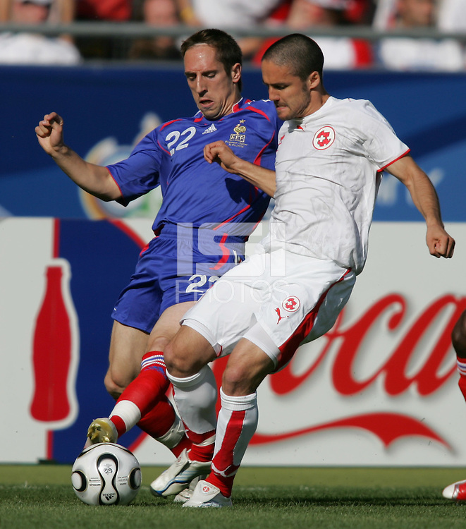 French midfielder (22) Frank Ribery tries to take the ball from Swiss defender (23) Philipp Degen. France and Switzerland played to a 0-0 tie in their FIFA World Cup Group G match at the Gottlieb-Daimler-Stadion, Stuttgart, Germany, June 13, 2006.