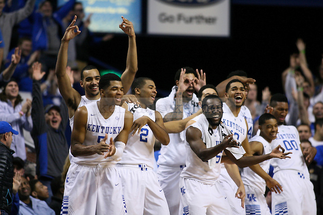The UK bench celebrates following Derek Willis' late three pointer at the end of the University of Kentucky versus University of Missouri men's basketball game at Rupp Arena in Lexington, Ky., on Tuesday, January 13, 2015. Photo by Cameron Sadler | Staff