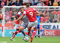 Lincoln City's Harry Toffolo vies for possession with Rotherham United's Jamie Proctor<br /> <br /> Photographer Chris Vaughan/CameraSport<br /> <br /> The EFL Sky Bet Championship - Rotherham United v Lincoln City - Saturday 10th August 2019 - New York Stadium - Rotherham<br /> <br /> World Copyright © 2019 CameraSport. All rights reserved. 43 Linden Ave. Countesthorpe. Leicester. England. LE8 5PG - Tel: +44 (0) 116 277 4147 - admin@camerasport.com - www.camerasport.com