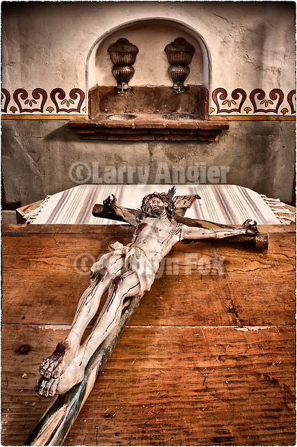Ancient and historic crucifix with the body of Christ in sacristy, Mission San Antonio de Padua, California.