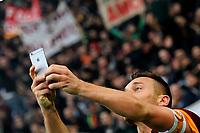 Francesco Totti of AS Roma makes himself a selfie after scoring the goal of 2-2 <br /> Esultanza Gol Francesco Totti Roma . Goal celebration 2-2 Selfie Con telefonino <br /> Roma 11-01-2015 Stadio Olimpico, Football Calcio Serie A AS Roma - Lazio . Foto Andrea Staccioli / Insidefoto