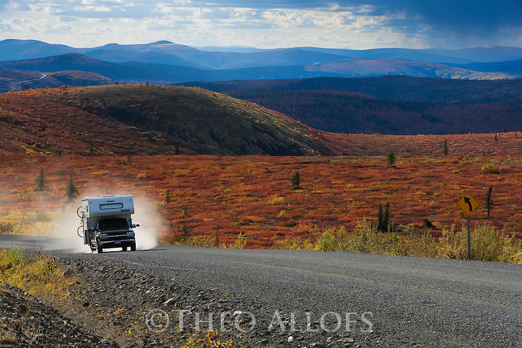 """Pickup camper driving on the """"Top of the World Highway""""  between Dawson City/Yukon and Tok/Alaska"""