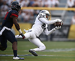 Nevada's Jerico Richardson makes a reception against Arizona's Will Parks in an NCAA college football game in Reno, Nev., on Saturday, Sept. 12, 2015.(AP Photo/Cathleen Allison)