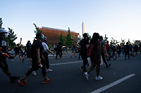 Demonstrators march past the Smithsonian National Museum of African American History and Culture in Washington, D.C., U.S., on Sunday, May 31, 2020, following the death of an unarmed black man at the hands of Minnesota police on May 25, 2020.  Credit: Stefani Reynolds / CNP/AdMedia