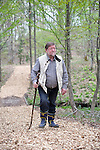 Author and naturalist C.W. Nicol walks through the C.W. Nicol Afan Woodland Trust, native woodland that he began buying up 25 years ago, near his home in Kurohime, Nagano Prefecture, Japan on 10 May 2010..Photographer: Robert Gilhooly