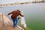 A group of America Model Yachting Association members race their small boats in Viewpoint Lake on  December 1, 2013.