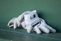 A pair of Franklin brand batting gloves sit on the bench in the Delmarva Shorebirds dugout during the game against the Kannapolis Intimidators at Kannapolis Intimidators Stadium on April 13, 2016 in Kannapolis, North Carolina.  The Intimidators defeated the Shorebirds 8-7.  (Brian Westerholt/Four Seam Images)