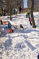 Visitors to Central Park sled down the aftermath of Winter Storm Jonas on Sunday, January 24, 2016. The blizzard dumped 26.8 inches onto Central Park making it the second-highest amount since records started in 1869.  (© Richard B. Levine)