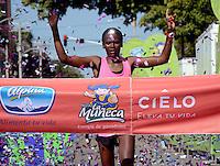 """BARRANQUILLA -COLOMBIA-30-NOVIEMBRE-2014. En forma brillante concluyo el circuito de la Carrera de la Mujer en Colombia con la victoria de la keniata Pamela Chepkoech, quien emple— un tiempo de 40Õ06Ó para el recorrido de 12 kil—metros por las calles de Barranquilla con la participacion de unas 5000 atletas. / brilliantly conclude the circuit in Career Women in Colombia with the victory of the Kenyan Pamela Chepkoech, who used a time of 40'06 """"for travel 12 kilometers through the streets of Barranquilla with the participation of about 5,000 athletes .  Photo: VizzorImage / Alfonso Cervantes / Stringer"""