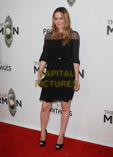 "Alicia Silverstone  .""The Book of Mormon"" Hollywood Opening night Held At The Pantages theatre, Hollywood, California, USA..September 12th, 2012.full length dress black lace belt clutch bag.CAP/ADM/KB.©Kevan Brooks/AdMedia/Capital Pictures."