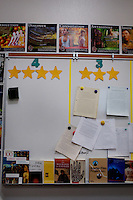 Lindsay, California, September 5, 2012 - The dry erase board in Amalia Lopez's English class at Lindsay High School shows work from its level 3 and level 4 students, both of which share the same class. ..Lindsay High School began building a competency-based education model about 7 years ago, fully implementing it just over three years ago and is set to graduate its first class this school year. This model does away with traditional grading and pass/fail for grades. Instead students are expected to achieve proficiency in a range of areas in each class, where a 3 (equal to a traditional B) is passing; A 4 is considered intensive and usually denotes college bound. Says Principal Jaime Robles, ?This allows students to learn at there own pace. If a student is advanced, they can move ahead, and if a student is lagging, they get the support they need.? Part of this model allows for students who are more advanced dig deeper and push harder and truly move ahead of others. Because they are ahead, some spend the extra time learning more, others take concurrent classes at the nearby community college and some choose to graduate early to start their path. ?Each student has their own set of goals,? says English teacher Amalia Lopez, ?Whatever their goals are, we support them.?.Slug: DD_ CompetencyByline: Daryl Peveto / LUCEO for Education Week