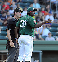 Manager Carlos Febles (33) of the Greenville Drive argues with umpire Mike Patterson in a game against the Rome Braves on May 6, 2012, at Fluor Field at the West End in Greenville, South Carolina. Greenville won, 11-3. (Tom Priddy/Four Seam Images).