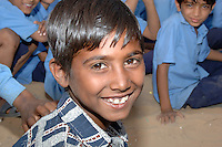 Portrait of young school boy in Rajasthan, India.