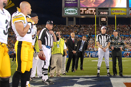 Tampa, FL - February 1, 2009 -- General David H. Petraeus, Commander, United States Central Command, far right, talks with head Super Bowl XLIII Referee, Terry McAulay prior to the coin toss, Sunday, February 1, 2009, at Raymond James Stadium in Tampa Florida. .Credit: Bradley Lail - USAF via CNP