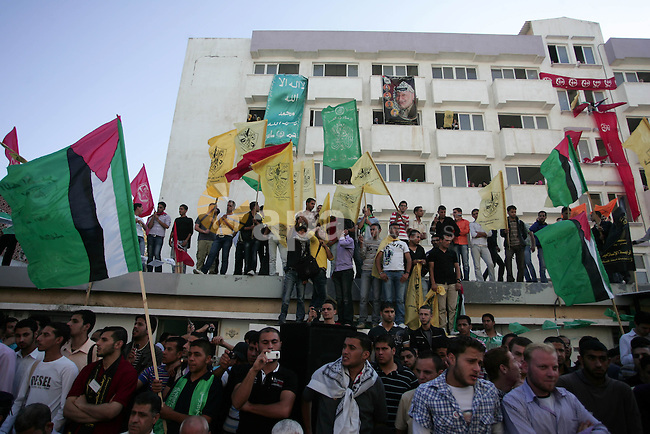 Palestinians participate in a rally celebrating the reconciliation agreement between Fatah and Hamas, at al-Azhar University in Gaza City, Sunday, May 8, 2011. Rival Palestinian factions Fatah and Hamas signed a landmark reconciliation pact on Wednesday, May 4, 2011 ending a four-year rift that had divided the territory envisioned for a future Palestinian state. Photo by Mohammed Othman
