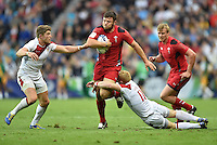 Wales's Luke Morgan evades the tackle of England's James Rodwell, left, and England's John Brake<br /> <br /> Wales Vs England - men's classification 5th - 6th place match<br /> <br /> Photographer Chris Vaughan/CameraSport<br /> <br /> 20th Commonwealth Games - Day 4 - Sunday 27th July 2014 - Rugby Sevens - Ibrox Stadium - Glasgow - UK<br /> <br /> © CameraSport - 43 Linden Ave. Countesthorpe. Leicester. England. LE8 5PG - Tel: +44 (0) 116 277 4147 - admin@camerasport.com - www.camerasport.com