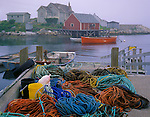 Halifax County, Nova Scota<br /> Colorful ropes cover a dock in Peggy's Cove with morning fog enveloping the village and harbor