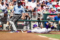 LSU Tigers outfielder Andrew Stevenson (6) slides headfirst into third base against the TCU Horned Frogs in the NCAA College World Series on June 14, 2015 at TD Ameritrade Park in Omaha, Nebraska. TCU defeated LSU 10-3. (Andrew Woolley/Four Seam Images)