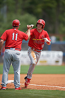 Palm Beach Cardinals manager Dann Bilardello (11) fist bumps Zach Kirtley (18) after a home run during a Florida State League game against the Charlotte Stone Crabs on April 14, 2019 at Charlotte Sports Park in Port Charlotte, Florida.  Palm Beach defeated Charlotte 5-3.  (Mike Janes/Four Seam Images)