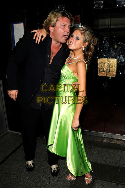 NIKKI GRAHAME & GUEST.Nikki Grahame's 26th birthday party, Embassy Club, London, England..APRIL 23rd, 2008.full length green silk satin dress mouth open arm on shoulder gesture tiara black suit .CAP/CAN.©Can Nguyen/Capital Pictures.