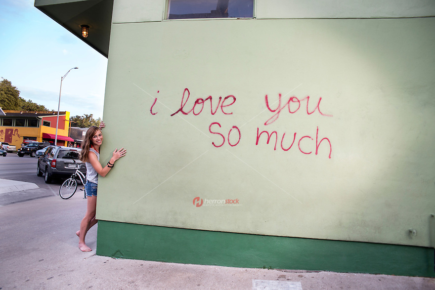 "The ""i love you so much"" mural is affixed to the South Congress Shopping District ""Keep Austin Weird"" culture."